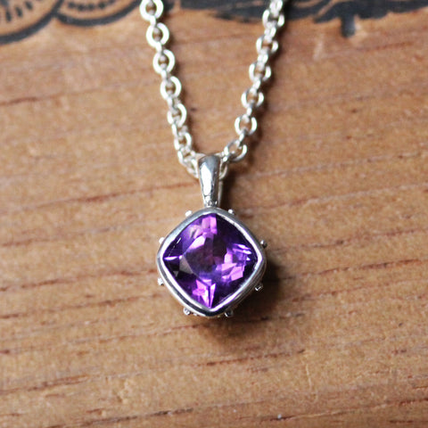 Sterling silver necklace with 7mm amethyst gemstone.