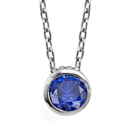 Sterling silver setting with imitation blue sapphire gemstones, slides along chain.