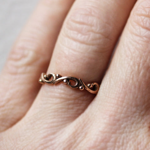 14k-rose-gold-swirl-band