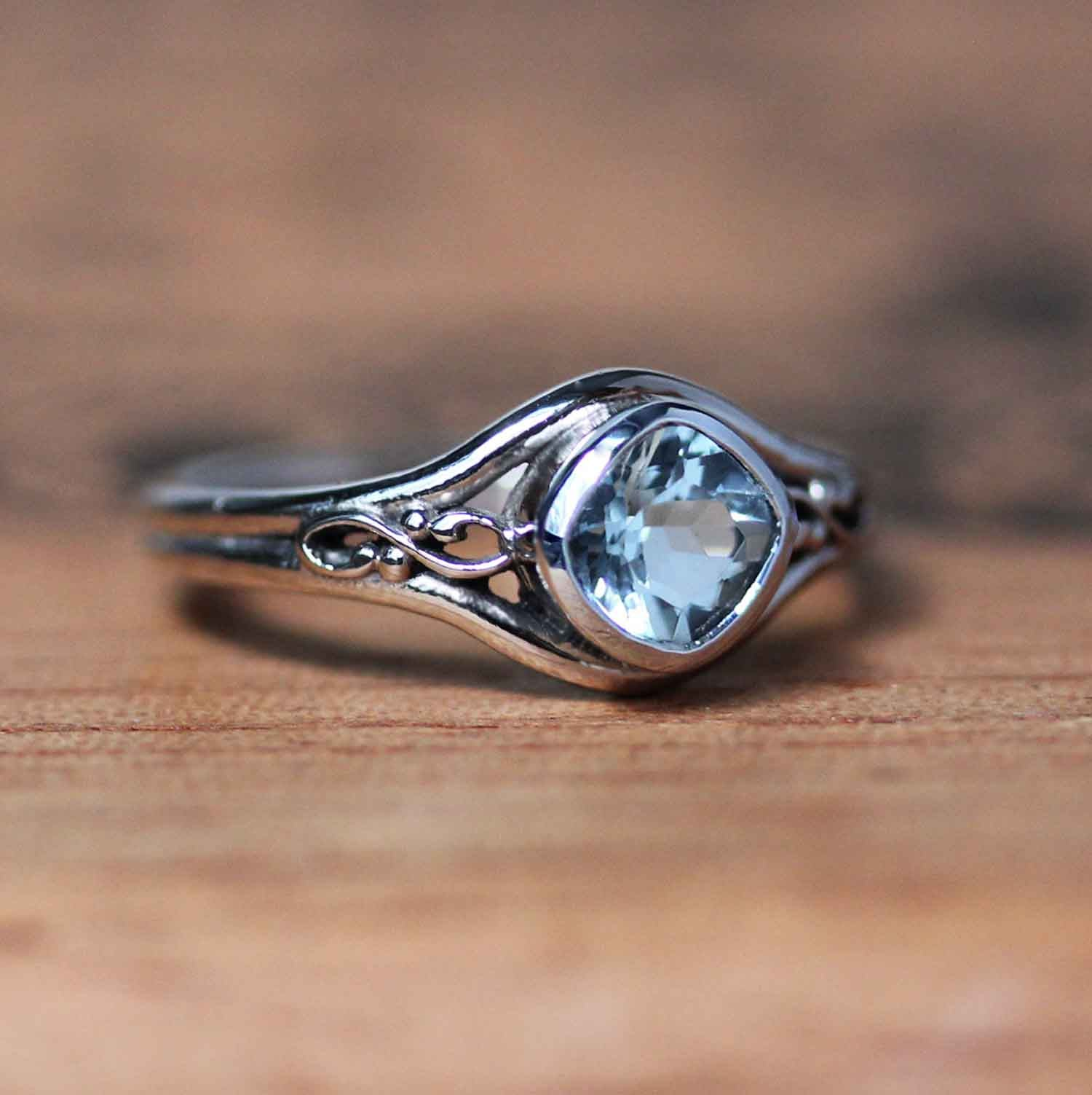 Silver infinity ring with square aquamarine