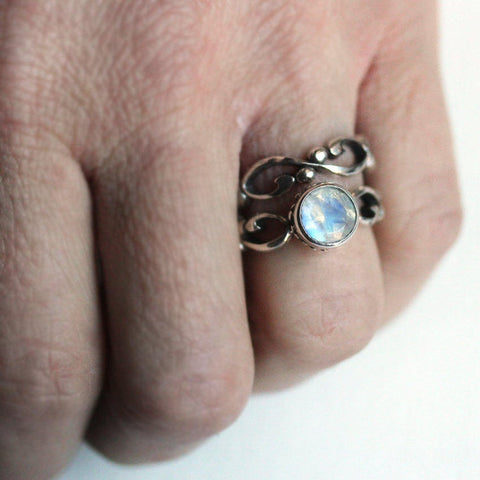 rainbow moonstone ring set on the hand
