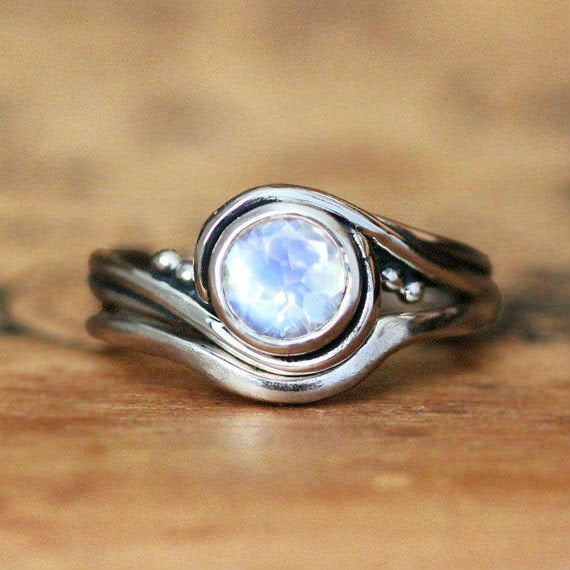 Close view of our handmade engagement ring set with a rainbow moonstone from Metalicious