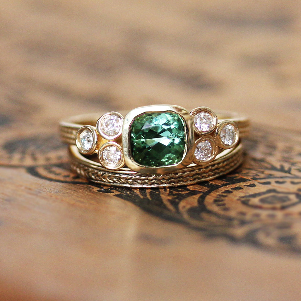 Close view of green tourmaline engagement ring set from Metalicious