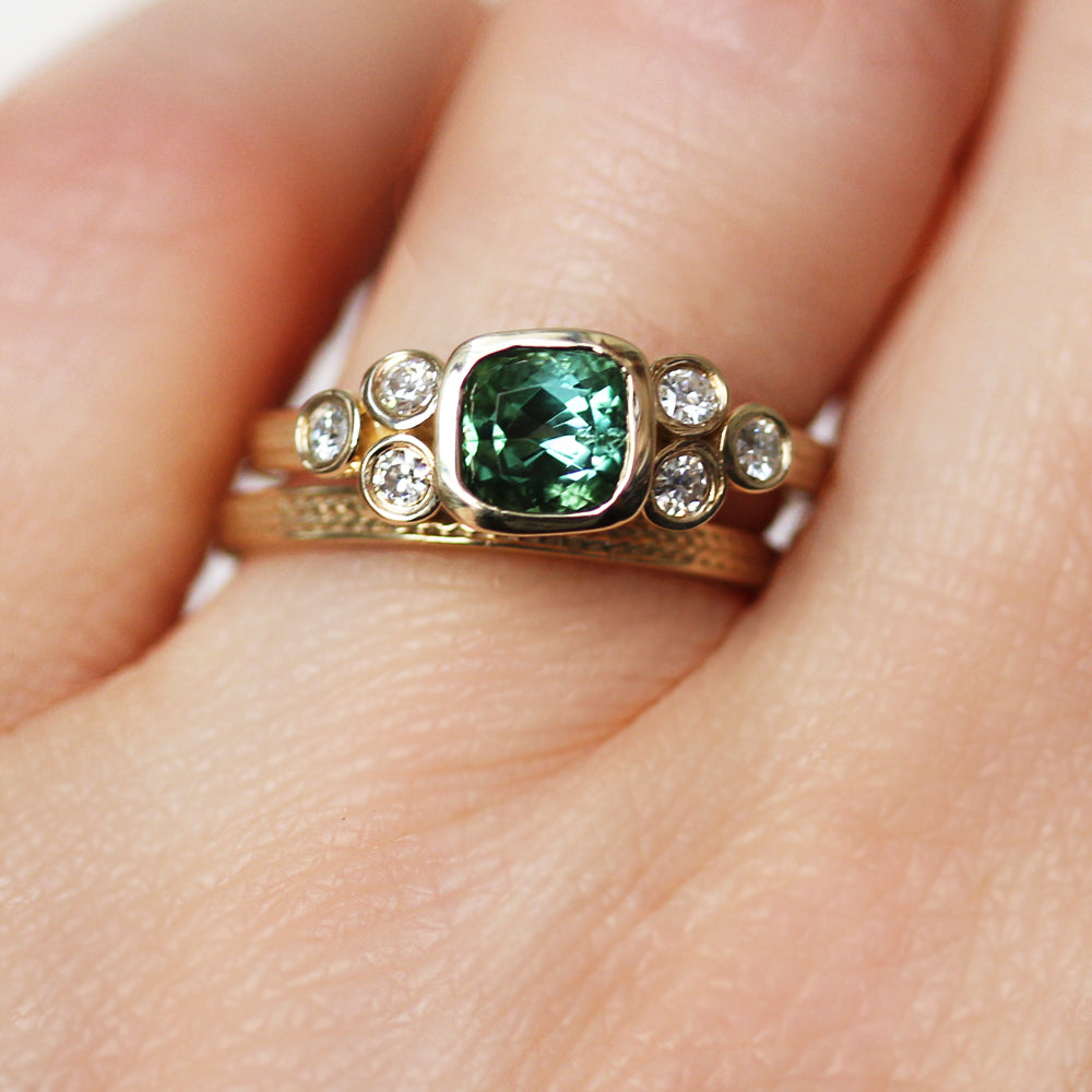 Custom engagement ring set with moissanite from Metalicious being worn