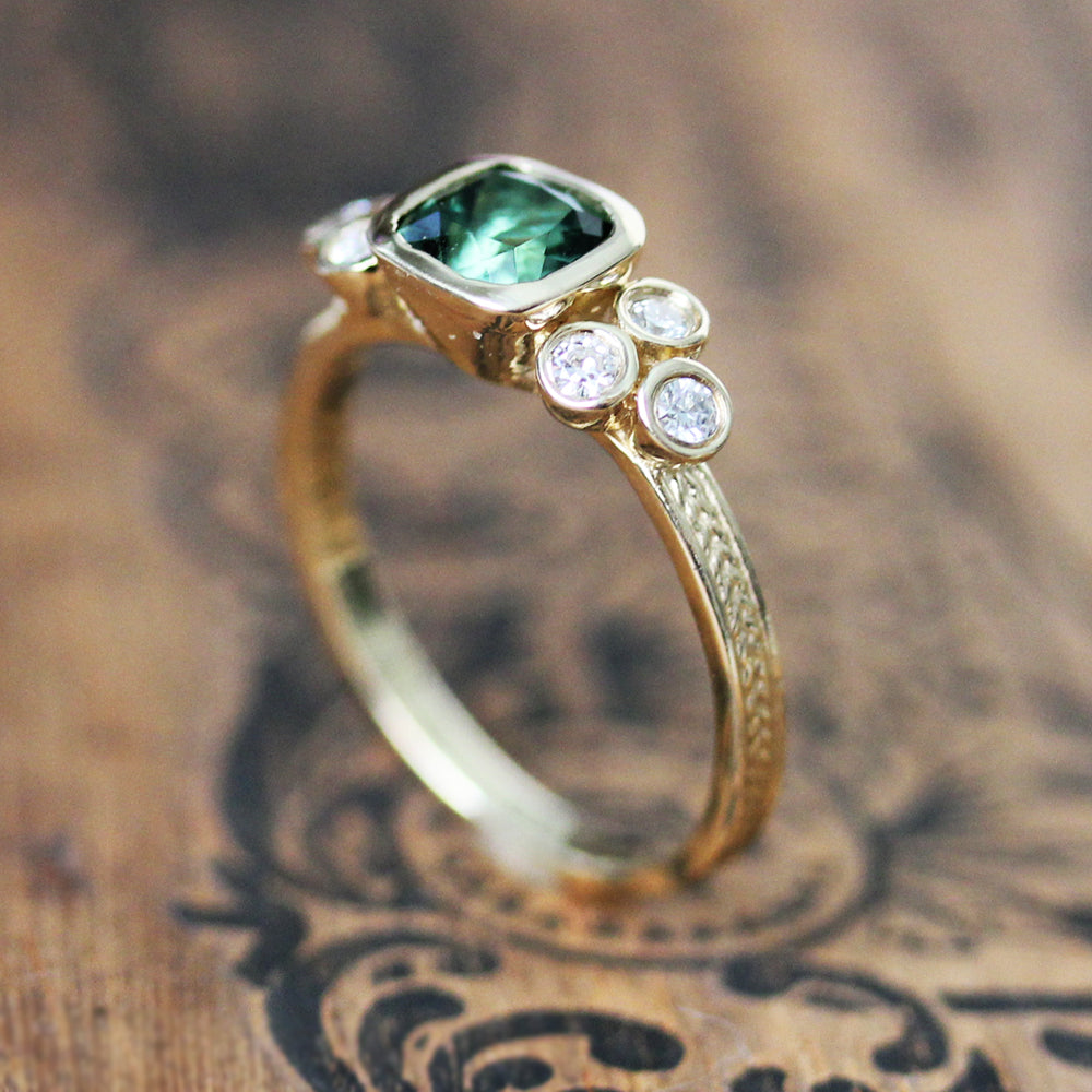 Green tourmaline engagement ring set from Metalicious standing up