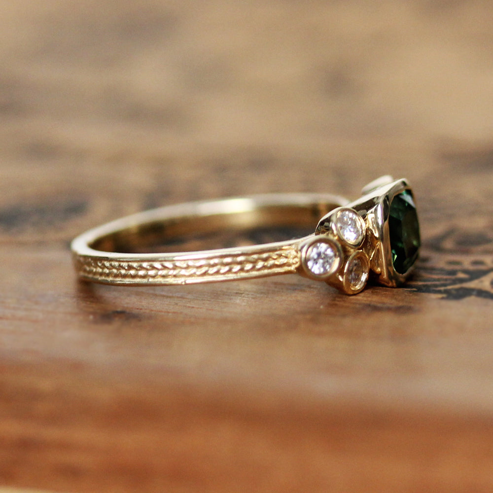 Side view of our gold and green tourmaline engagement ring set from Metalicious