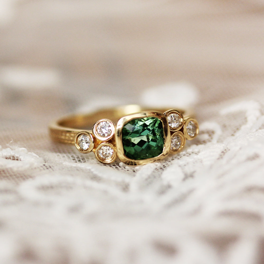 View of the handmade green tourmaline engagement ring set from Metalicious