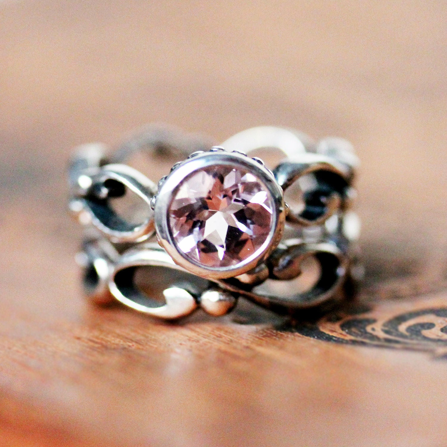 Close view of a custom engagement ring made of sterling silver and pink morganite from Metalicious