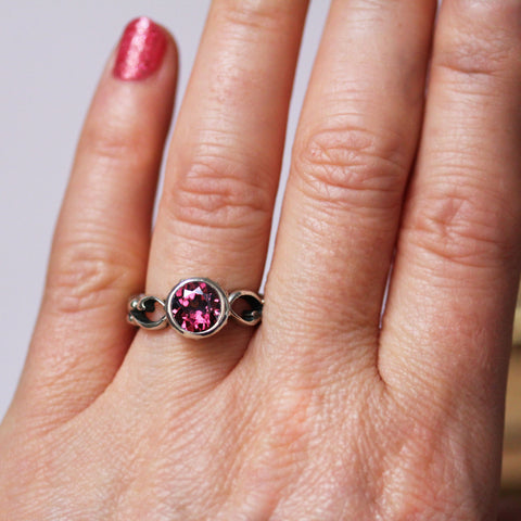 Rhodolite Garnet Ring on Ring Finger