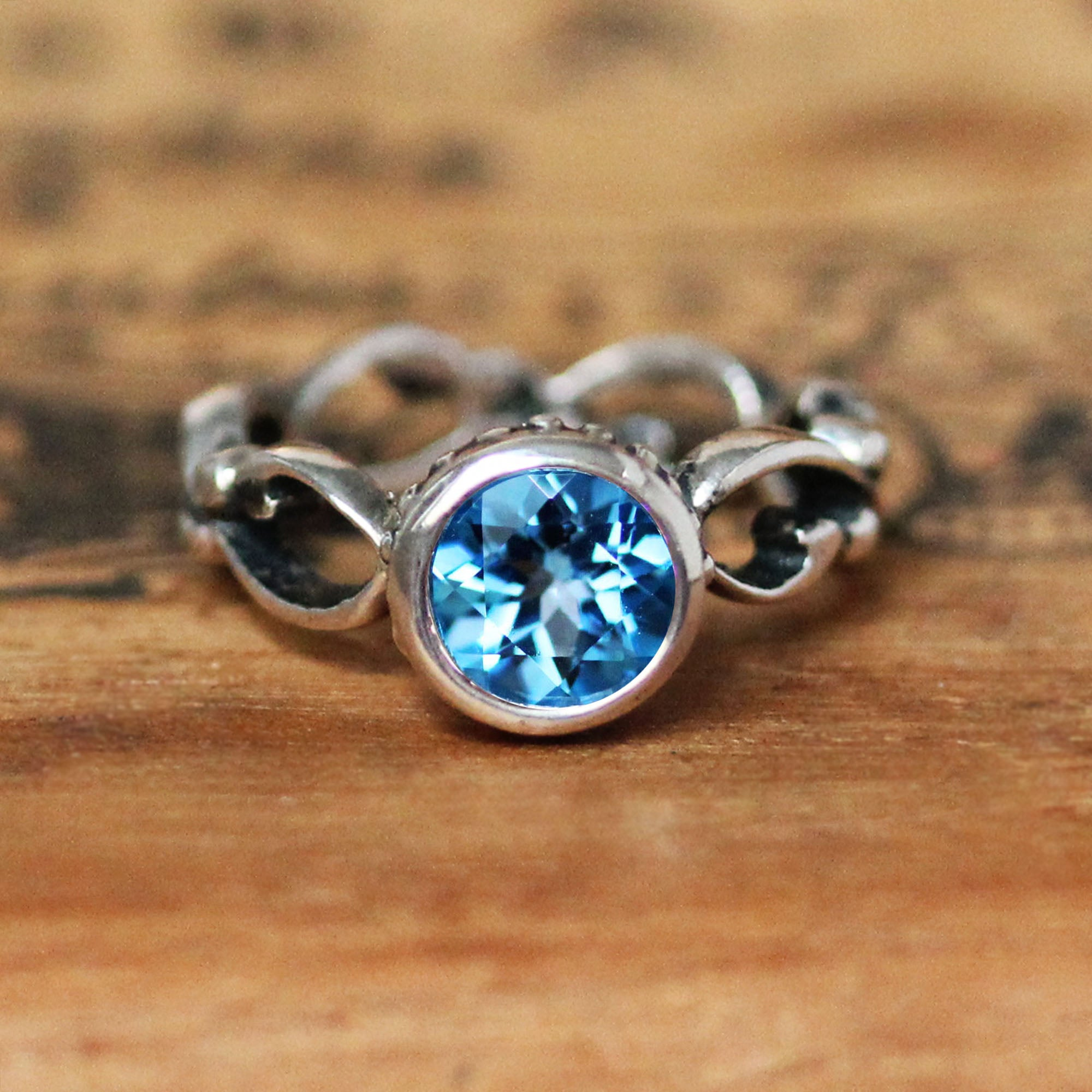 Sterling Silver Wrought Ring with Swiss Blue Topaz