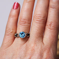 Swiss Blue Topaz Ring on hand