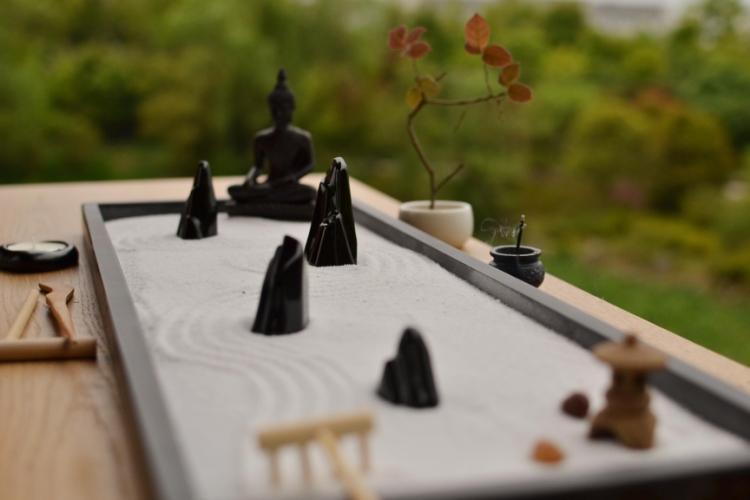 Relax and meditate with this Traditional Chinese Yoga Zen Garden - Ebony Buddha Set
