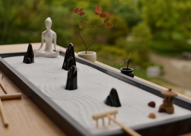 Relax and meditate with this Traditional Chinese Yoga Zen Garden - Ivory Buddha set