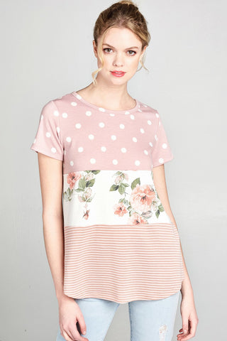 French terry knit top with multi print polka dot, floral, and stripe tiered patterns