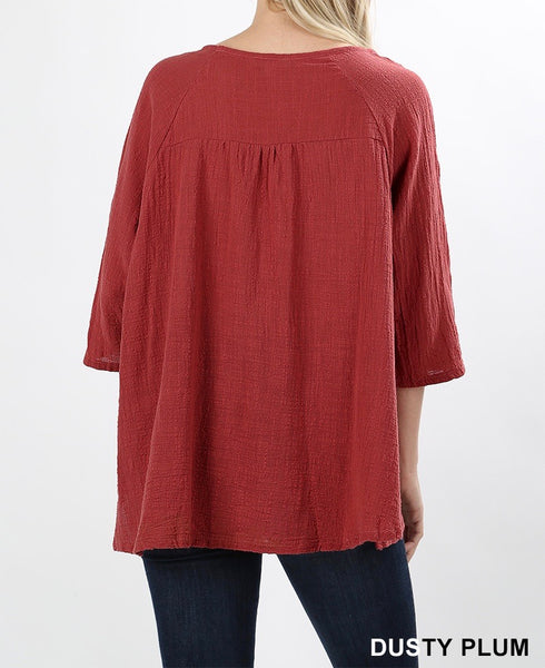 Gauze top with pockets in high low hem in dusty plum back
