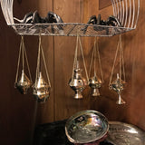 6Witch3 small brass incense burners - shown hanging from a wire birdcage displayed with two iron spiders and some abalone shells