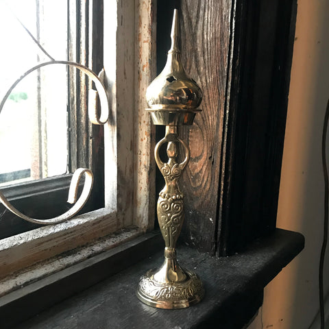 6Witch3 Brass Goddess Incense Holder shown on a windowsill