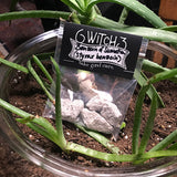 6Witch3 Benzoin of Sumatra resin shown bagged in a glass bowl with dirt and three delighted aloe plants.