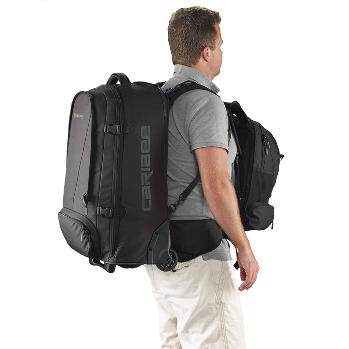 Caribee Sky Master 70L wheel travel backpack on model with daypack on front