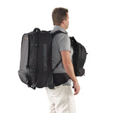 Caribee Sky Master 80L wheel travel backpack on model with daypack on front
