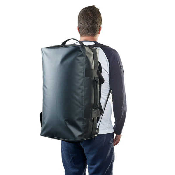 Caribee Titan 50L Gear Bag Black with shoulder straps on person