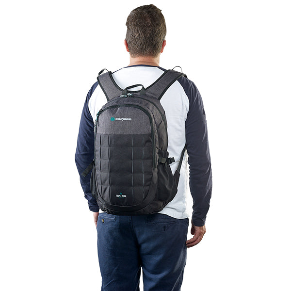Caribee Triple Peak 28 backpack black on model