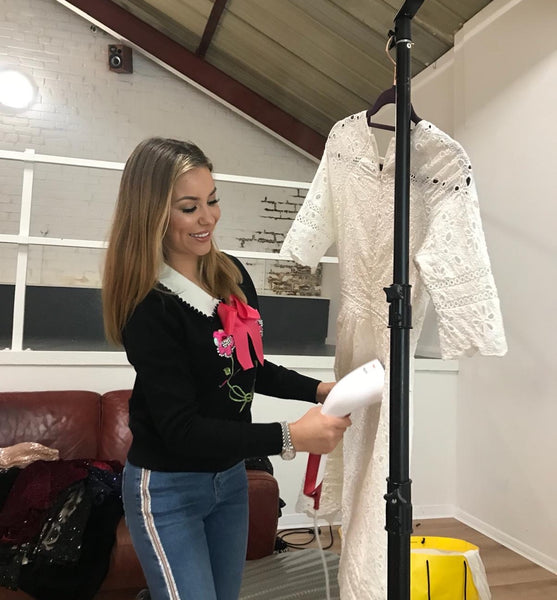 Youma Leth steaming the Athenes dress in the studio