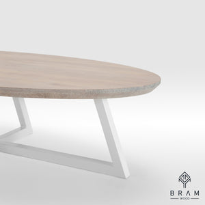 Oval Form Coffee Table With Angled Steel Legs