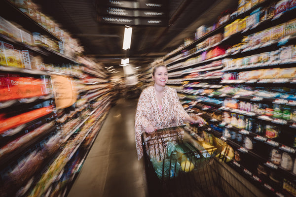 Woman wearing a a Highway Robery bathrobe while going grocery shopping