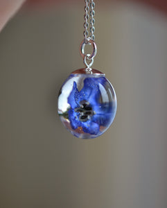 Blue flower resin necklace with Green Alkanet
