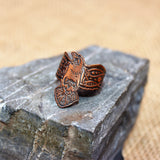 Copper raven ring cutout