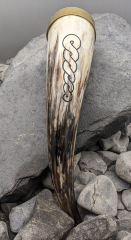 Brass rim and braid drinking horn