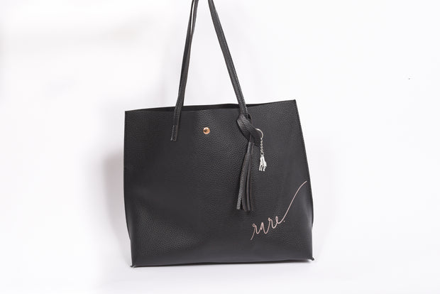 Scripted RARE. Lightweight Leather Everyday bag with inside pocket and signature RARE. tassle - RARE.