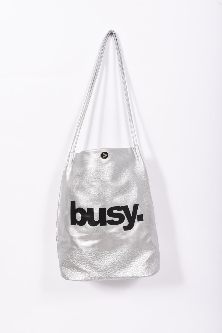 Busy. Bucket Bag with RARE. Signature tassel and charm - RARE.