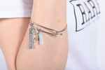 RARE. Signature Bangle with 2 Charms