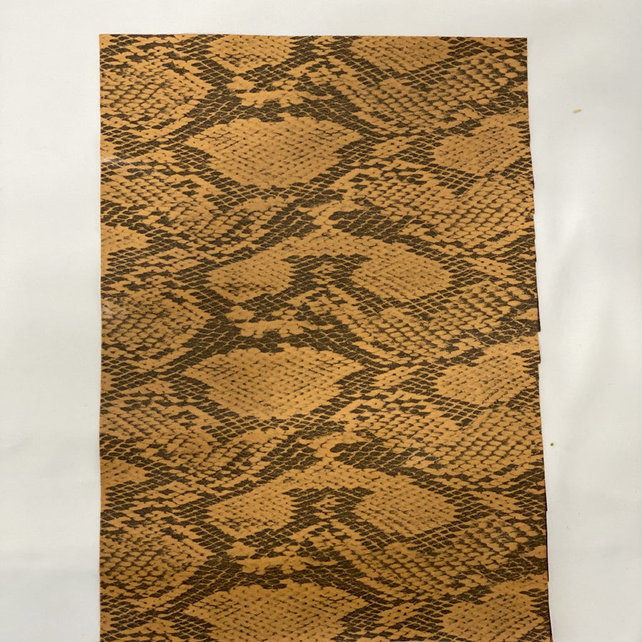Gold Piuma Snakeskin Vinyl Fabric - Fashion Fabrics Los Angeles