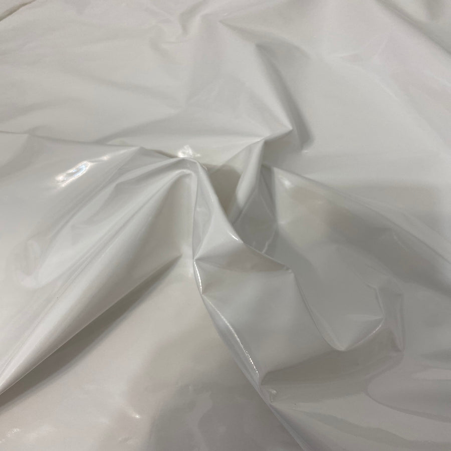 White Faux Patent Leather Apparel Vinyl Fabric - Fashion Fabrics LLC