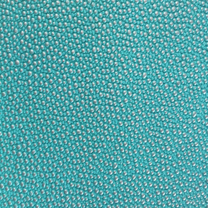 Turquoise Silver Pebbled Dotted Vinyl Fabric - Fashion Fabrics Los Angeles