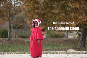 Girl wearing a christmas cloak made from the anaheim cloak pattern