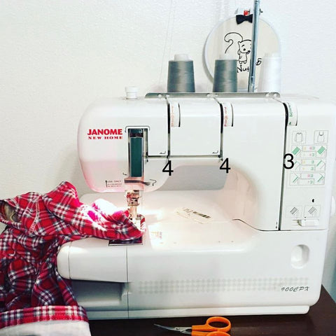 janome 900cpx with red plaid fabric being sewn
