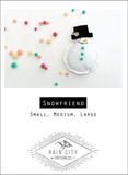 snowman with black top hat on white background surrounded by colorful pompoms