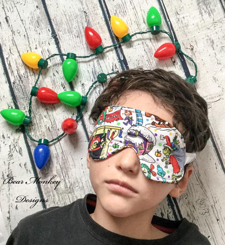 christmas picture of a boy wearing a christmas sleep mask