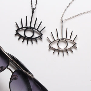 Metal hollow out eye pendant necklace