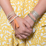 model wearing Tiana thin gold leather wrap bracelet- Amy Margaret