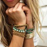 Amy Margaret model photo of Tiana wrap bracelet in metallic gold and cork/gold