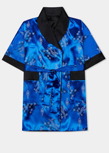Traditionally styled fully reversible kimono with shawl collar, patch pockets and tie belt. Manufactured in a rich royal blue silky rayon/polyester with a bird of paradise and Chinese lantern print - a symbol of joy and good fortune to one side. Solid black with large dragon embroidery to reverse side.