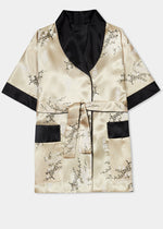 Traditionally styled fully reversible kimono with shawl collar, patch pockets and tie belt. Manufactured in a classic gold silky rayon/polyester with a bird of paradise and Chinese lantern print - a symbol of joy and good fortune to one side. Solid black with large dragon embroidery to reverse side.