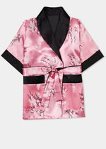 Traditionally styled fully reversible kimono with shawl collar, patch pockets and tie belt. Manufactured in a beautiful pink silky rayon/polyester with a bird of paradise and Chinese lantern print - a symbol of joy and good fortune to one side. Solid black with large dragon embroidery to reverse side.