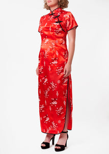 The Cheongsam or Qipao, is a feminine body-hugging dress with distinctive Chinese features of mandarin collar, side splits and flower and knot frog fastenings. Manufactured in stunning red silky polyester with a bird of paradise and Chinese lantern print - a symbol of joy and good fortune