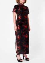 The Cheongsam or Qipao, is a feminine body-hugging dress with distinctive Chinese features of mandarin collar, side splits and flower frog fastenings. Manufactured in high quality silk/rayon brocade fabric which has a beautiful lustre. In black with a red cherry blossom design - a symbol of female beauty and love.